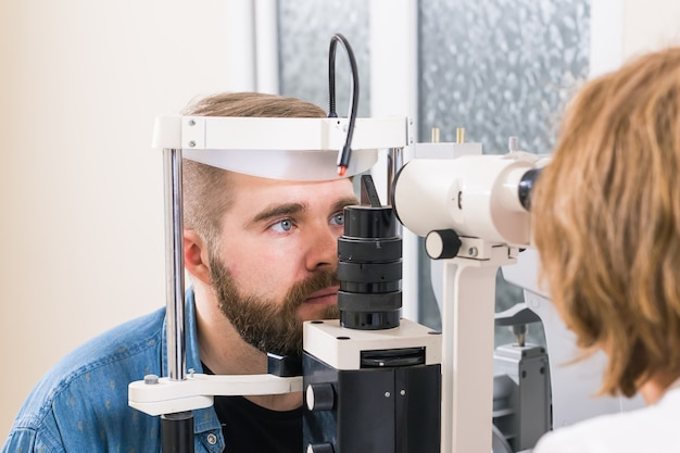 Patient checks her vision by an ophthalmologist