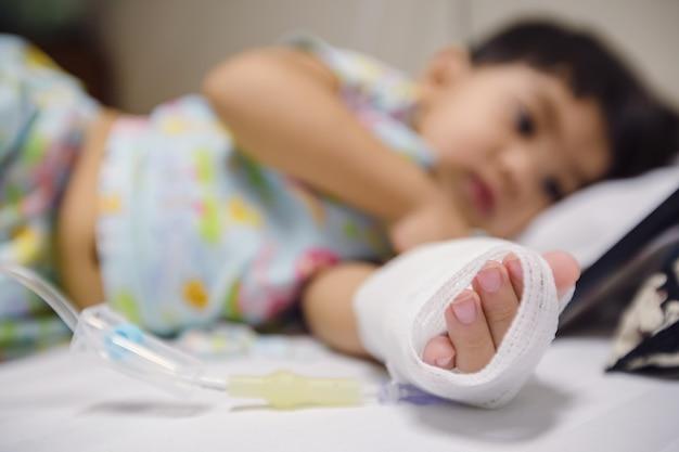 Patient children sleeping on patient bed