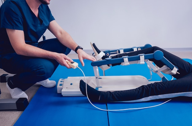 Patient on cpm (continuous passive range of motion) machines. device to provide anatomically correct motion to both the ankle and subtalar joints.