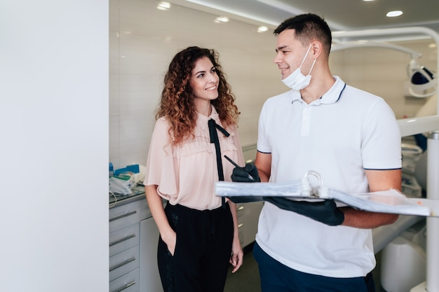 Patient and dentist looking at each other in the office