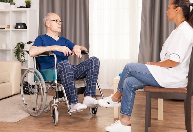 Patient and doctor talking in cozy apartment.