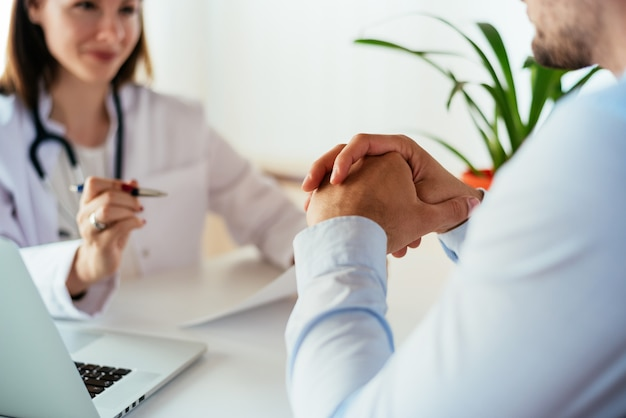 Patient having consultation with doctor in office
