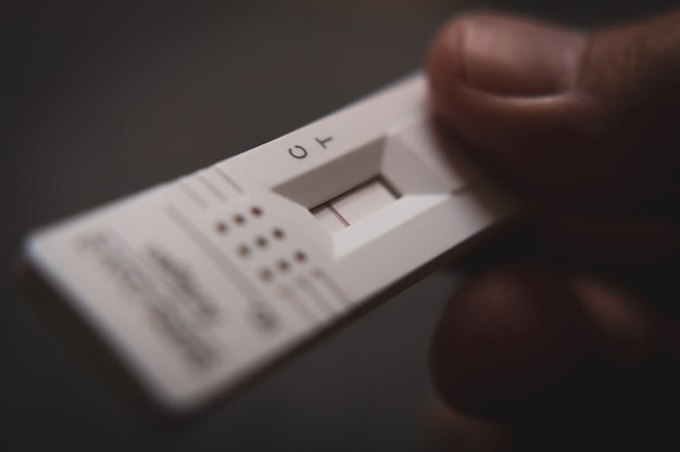 Patient holding a test kit for viral disease covid-19 2019-ncov. result is negative.