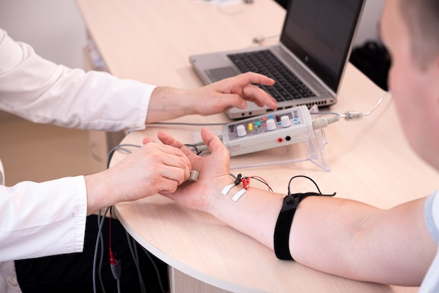 Patient nerves testing using electromyography at medical center