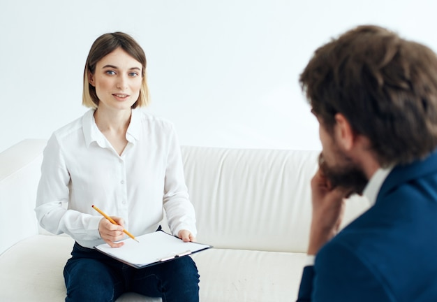 The patient sits with a psychologist psychotherapy communication stress