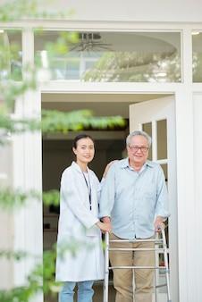 Patient walking with nurse