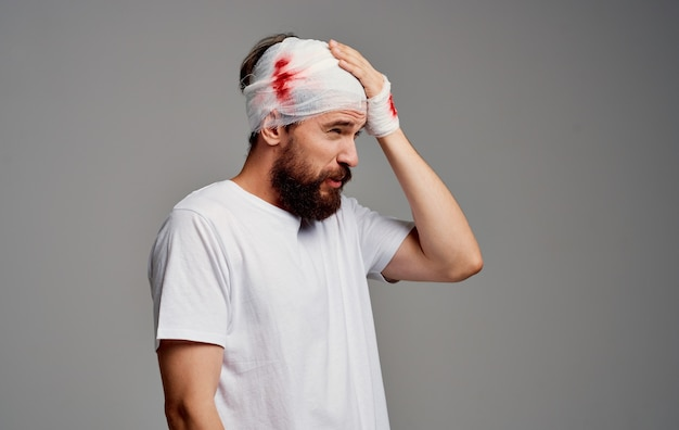Patient with bandaged head and arm health problems studio