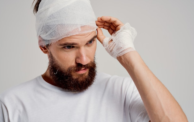 Patient with bandaged head health problems discontent trauma center