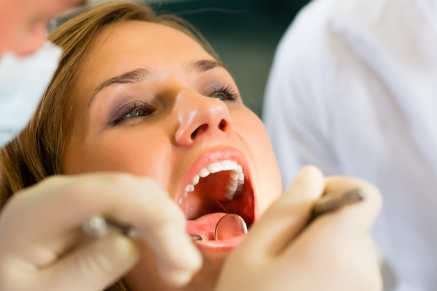 Patient with dentist, dental treatment