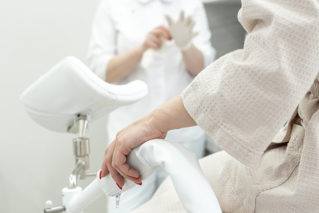 Patient with a gynecologist in the gynecological office