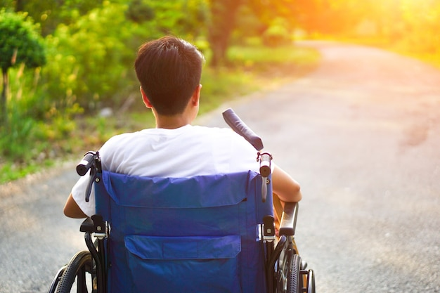Patients or disabled sitting on a wheelchair looking forward with hope