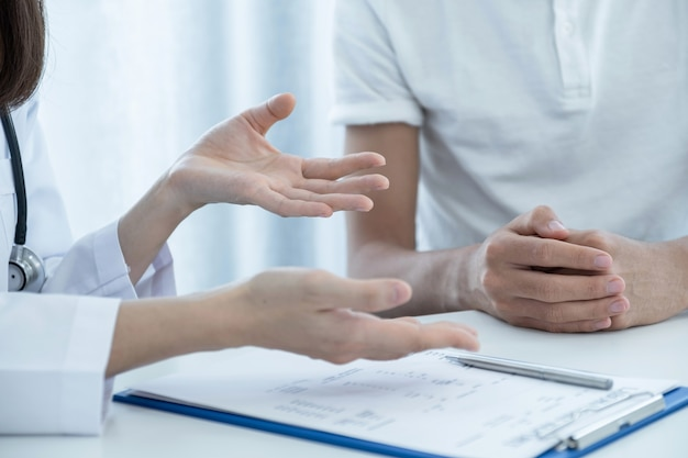 Patients hands, doctors report health examination results and recommend medication to patients.