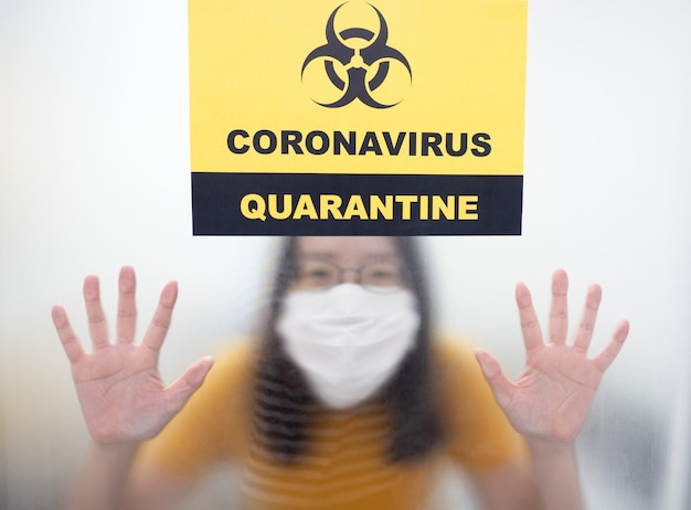 Patients with coronavirus infection in negative pressure room in covid-19 quarantine area during treatment with quarantine alert sign at hospital