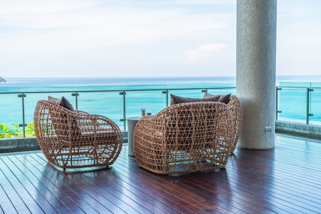 Patio chair and table with sea view background