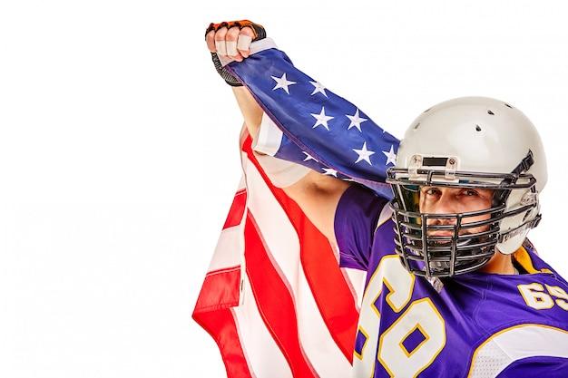 Patriotic american football player posing