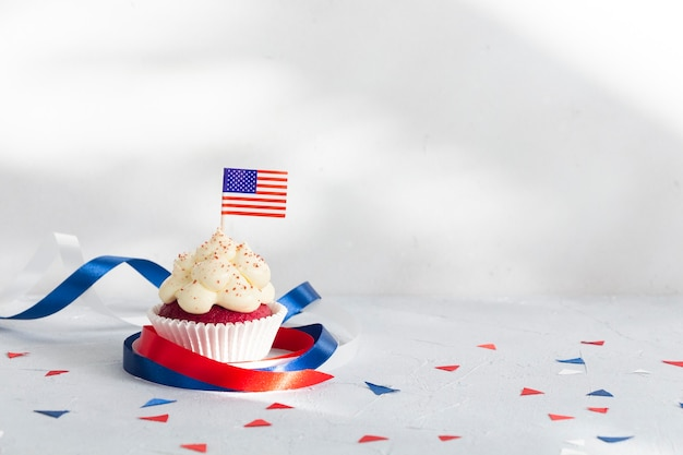 Patriotic cupcake with american flag decorated with ribbons the th of july celebration