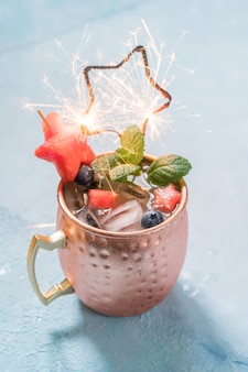 Patriotic moscow mule cocktail with watermelon and blueberry