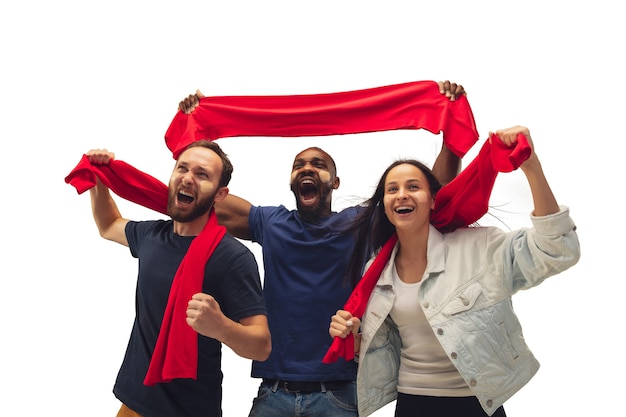 Patriotic. multiethnic soccer fans cheering for favourite team with bright emotions isolated on white background. beautiful caucasian women look excited, supporting. concept of sport, fun, support.
