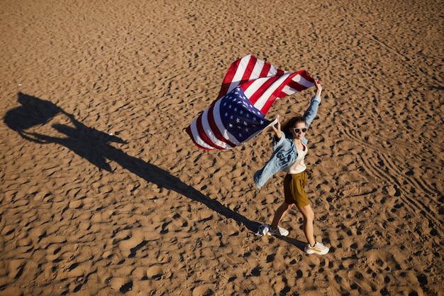 Patriotic woman holding american flag