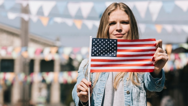 Patriotic woman showing usa flag at festival