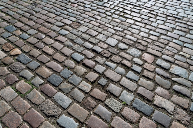 Pattern of ancient german cobblestone in city downtown.