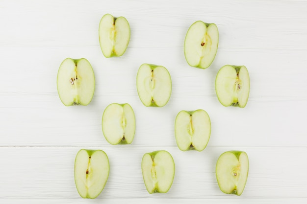 Pattern apple slices on white background