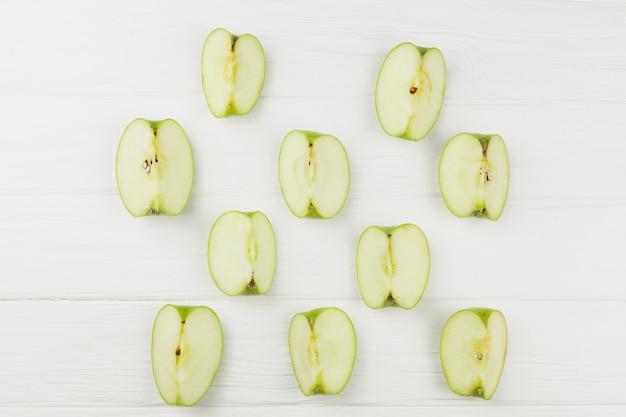Pattern apple slices on white background