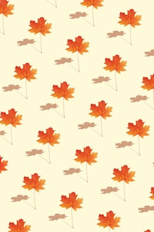 Pattern autumn maple leaf orange-red on yellow background in vertical format