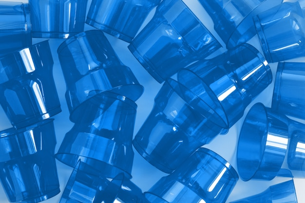 Pattern of blue disposable plastic cups.