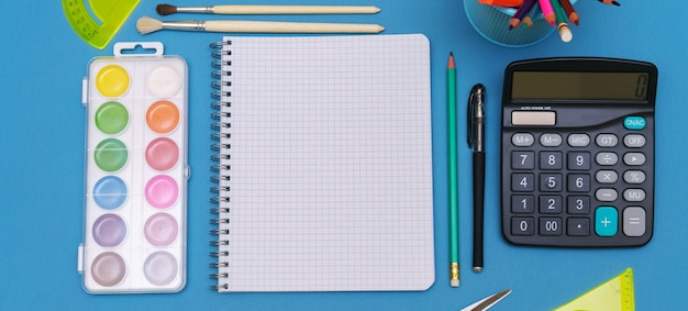 A pattern of brightly colored stationery accessories back to school education concept