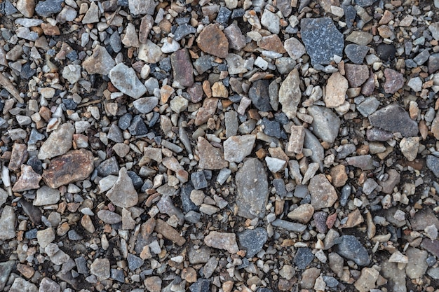 Pattern of crushed stones and gravel, abstract background texture