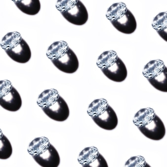 Pattern of crystal diamonds with shadow on white background