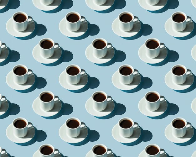 Pattern of cups with coffee on a blue surface