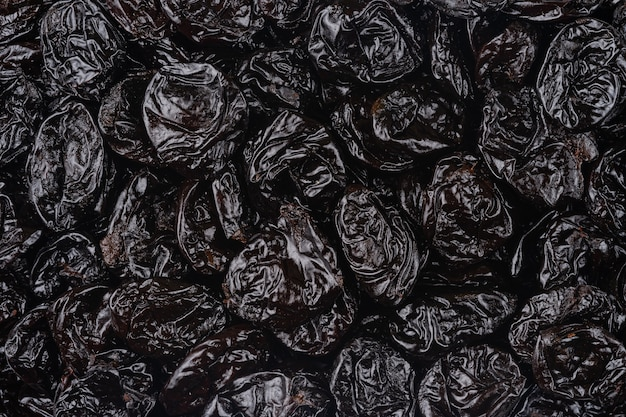 Pattern of dried prunes. top view, overhead.