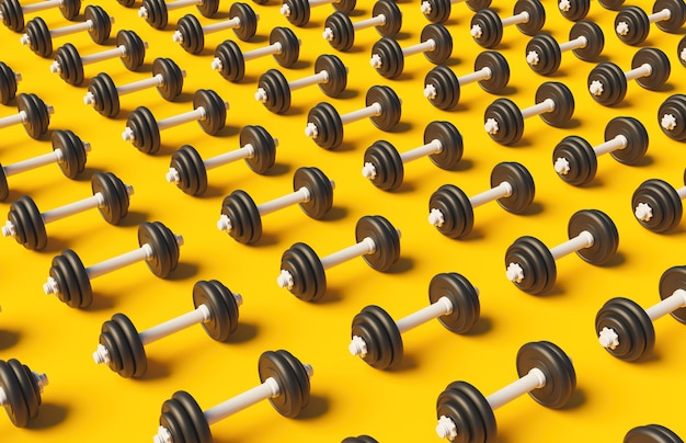 Pattern of dumbbells on yellow surface with soft shadow