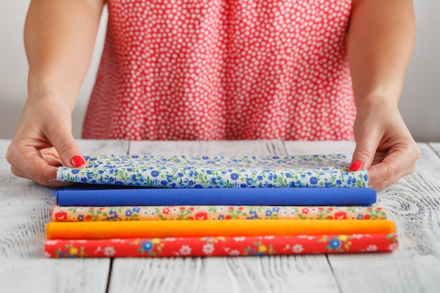 Pattern on fabrics and sewing accessories on a table
