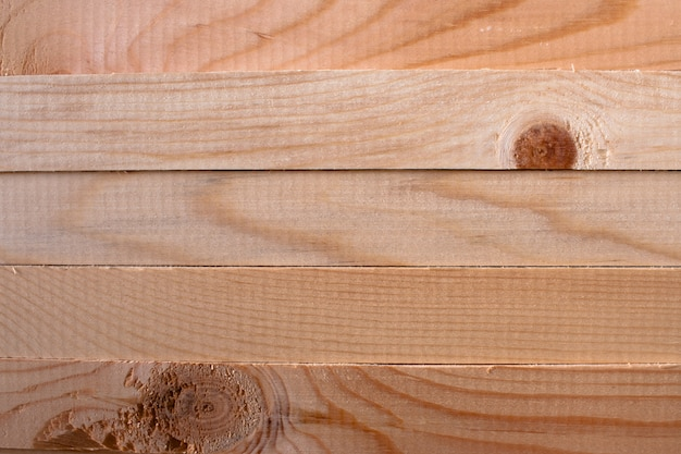 A pattern of five horizontal pine sticks
