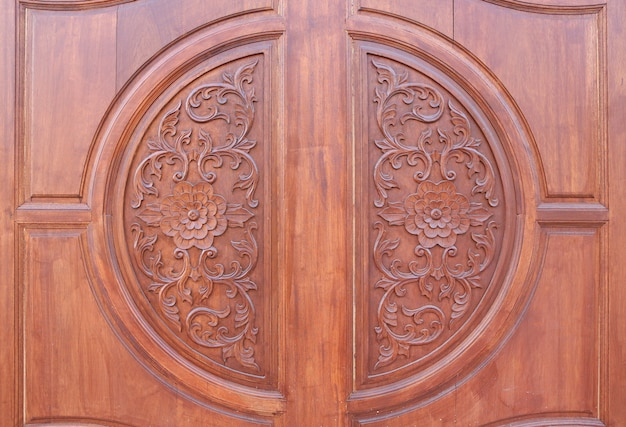 Pattern of flower carved on wood background. traditional wooden thai style