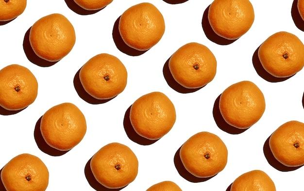 Узор из ярких мандариновых тропических оранжевых фруктов бесшовный фон фон
