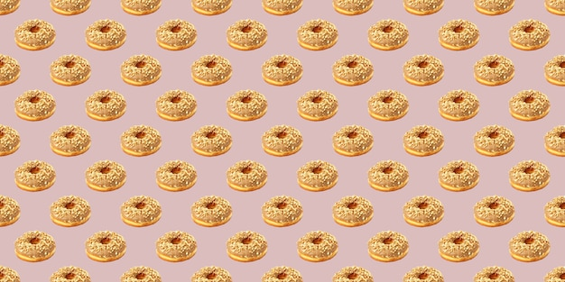 Pattern from chocolate donuts on a beige background