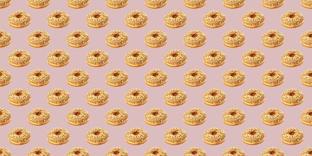 Узор из шоколадных пончиков на бежевом фоне