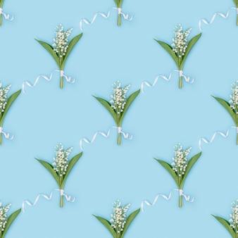 흰색 은방울꽃 피는 섬세한 봄 꽃의 패턴