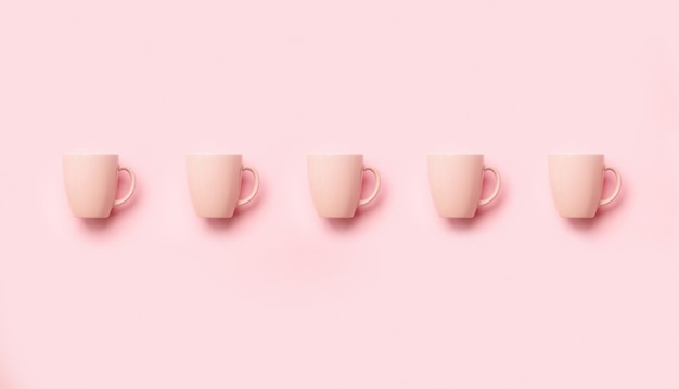 Pattern from pink cups over punchy background. birthday party celebration, baby shower concept. minimalist style design