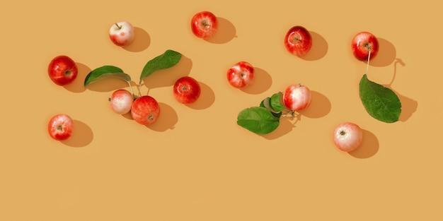 작은 빨간 사과와 어두운 그림자가있는 녹색 잎의 패턴