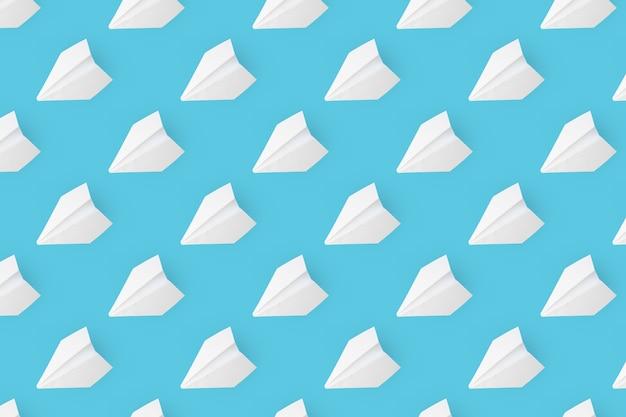 파란색 배경에 흰색 종이 비행기에서 패턴입니다.