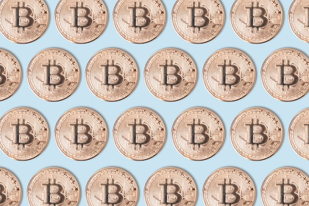 Pattern of golden bitcoins on blue background. cryptocurrency and money