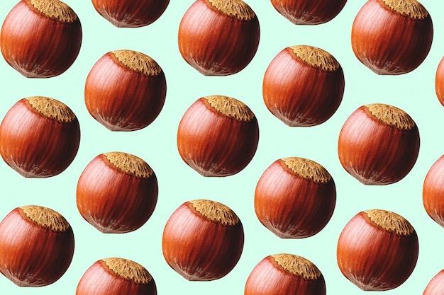 Pattern of a hazelnuts on colored background