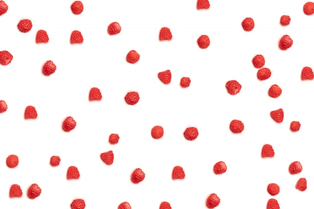 Pattern of jripe raspberries on a pink background. can be used for blog, poster or web banner.