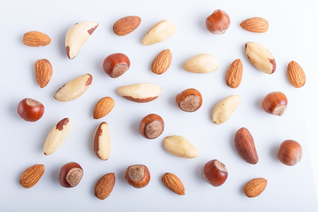 Pattern made from different kinds of nuts. isolated on white.