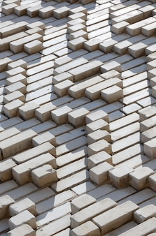 A pattern made of white bricks in the form of diamond shapes